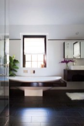 The glistening master bath has a contemporary aesthetic.