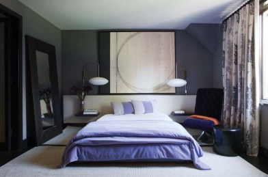 The designer's lush upholstered bed is graced with an oversized headboard. The swivel chair is covered in velvet.