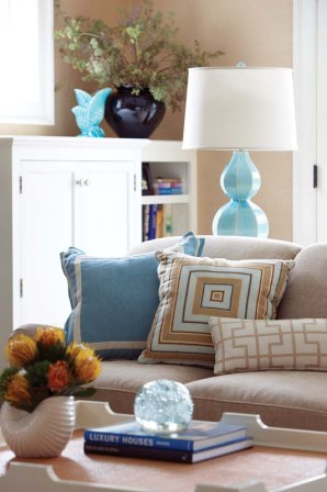 Family room accessories add some playful pattern to the solid backdrop.