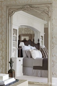 A freestanding wall of millwork in the center of the master bedroom ensconces the bed.