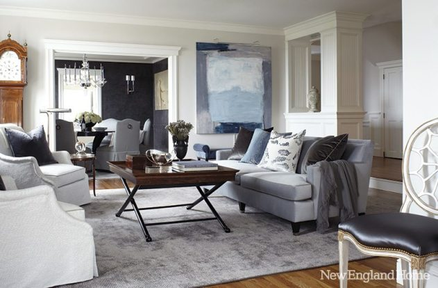 The living room's modern sensibility plays against the gentle patina of aged wood.