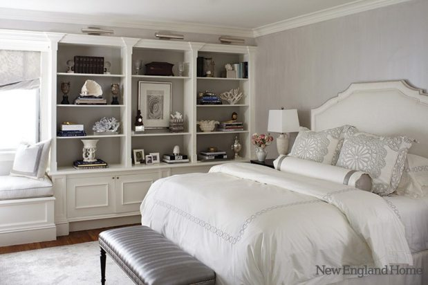 The master bedroom, with its gray stripe walls, is serene but personal.