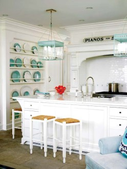 The kitchen island was designed to conceal a TV behind cupboard doors.