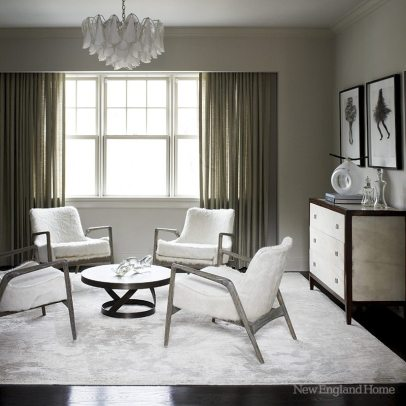 Silver freshened the sitting room's vintage chairs with white pony hide and her signature gray stain.