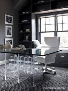 A vintage Lucite and glass table makes a sleek desk in the wife's second-floor office.
