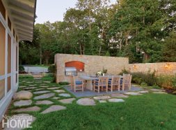 """A """"hidden garden"""" made by CBA Landscape Architects for a home in Marion, Massa-chusetts, includes an outdoor grill and dining room enclosed by stone walls modeled on those of Tuscany"""