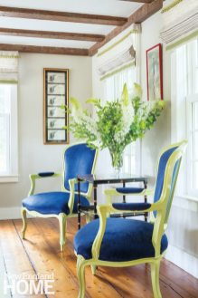 Architect Ramsay Gourd gave a pair of Louis XV–style chairs a twist with a bit of chartreuse paint and deep-blue upholstery