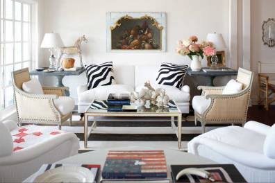 The living room is resplendent in its simplicity with white walls and accented by the owners' collection of Americana.