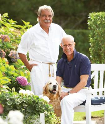 Bierly, Drake and their dog, Speedo, relax in their yard, once filled with scrub but now beautifully landscaped.