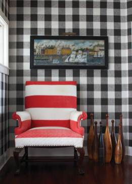 Foyer walls are meant to resemble a black-and-white quilt, playing off the red-and-white-striped quilt-covered chair.