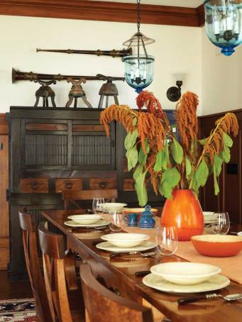 In the dining room, a Japanese tansu pairs nicely with the clean-lined Milling Road dining table.