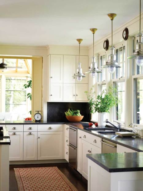 Light, bright and efficient describes the kitchen with its myriad windows and plentiful storage.