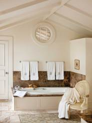 During the home's original renovation, Spada gutted the warren of upstairs rooms to create an under-the-eaves master bath.