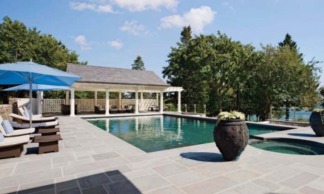 The pool, overlooking the Sakonnet, is surrounded by a wide bluestone deck