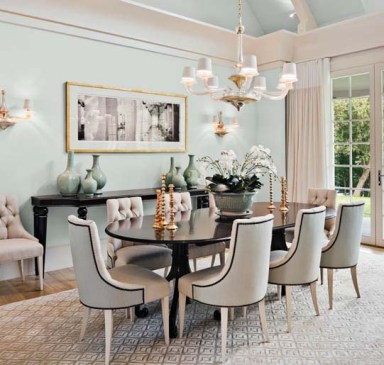 A pale sea-grass-colored wall and the custom table and chairs were designed to complement, not compete with, the water view