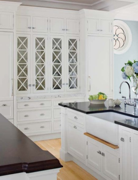 In the kitchen, built-in cabinets hide twin refrigerators; dual work islands are topped with mahogany and granite