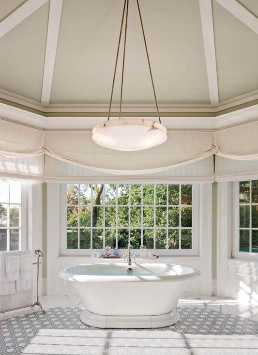 The master bath includes a soaking tub, a mosaic marble floor and a ceiling painted a watery blue-green