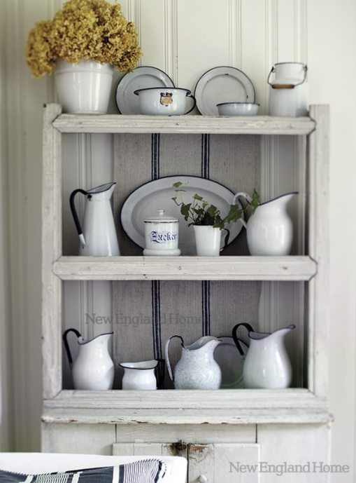 Designer/homeowner Nancy Ross collects German and English enamelware and old tin pieces.