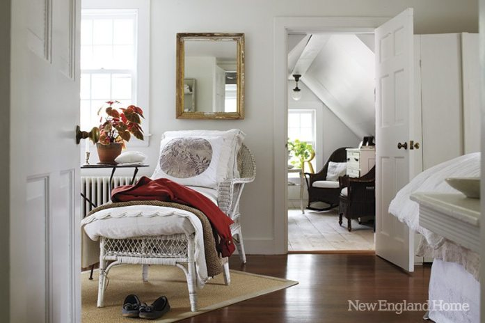 A pillow covered in French fabric highlights a lazy spot in the master bedroom.
