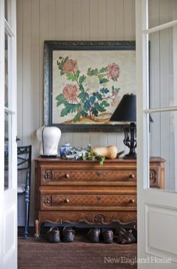 The designer added the vestibule off the home's porch as a place to take off muddy boots. A 1910 French oak chest holds gardening supplies.