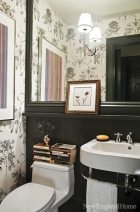 The tiny powder room ­features a romantic Sanderson wallpaper.