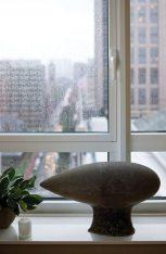 Pieces of art, like this sleek sculpture, lend interest but never clutter.