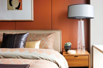 Bedrooms get a warm touch from paneling painted in rich shades.