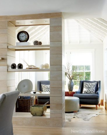 An intimate sitting area serves up view-giving windows on three sides.