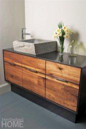 carved-stone-sink-on-steel-vanity