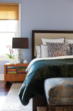 Lavender walls and textured bedding make the couple's master bedroom set look like new.