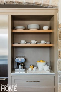 Built-in shelves by Michael Humphries Woodworking provide storage and display space.