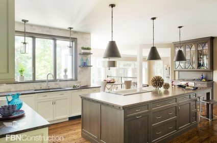 Transitional style kitchen with a mix of white cabinets and light wood built by FBN Construction