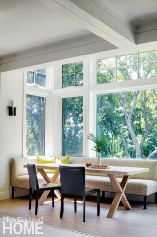 A sunny corner of the family room offers a light-filled space for casual dining or homework.