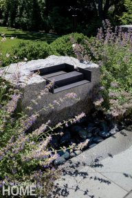 A fountain set into a block of Rockport granite provides background music.