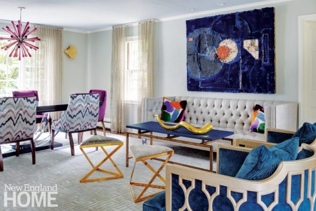 Splashes of vibrant solid colors enliven this living-dining room by Boston-area designer Heather Vaughan.