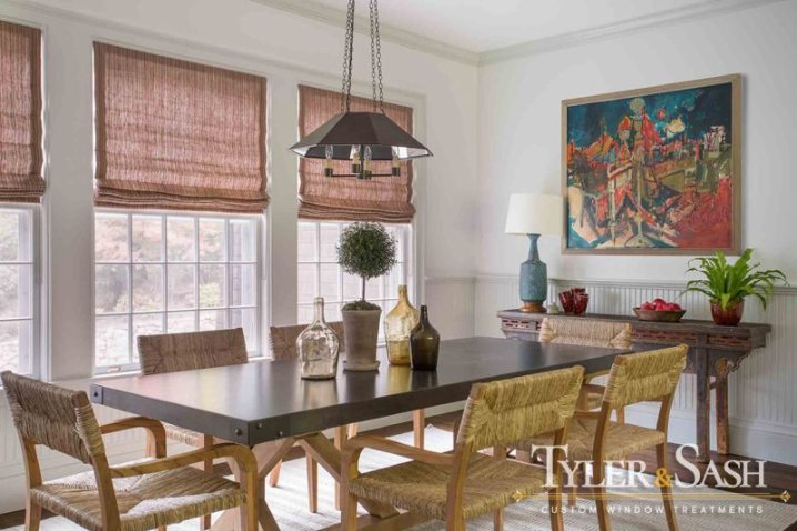 Dining nook with relaxed Roman shades