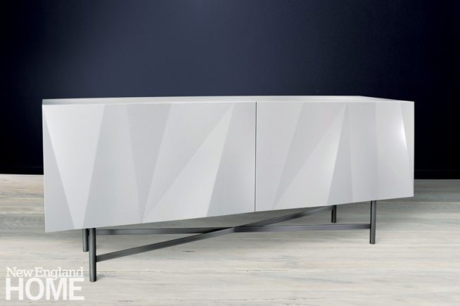 Custom pieces from Old Mill Road Table Company mimic popular designs while catering to a client's specific needs. A white lacquered dining room buffet is shown here.
