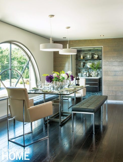 An oversize window offers views to the gardens and main house from the dining table, with additional illumination provided by a pair of Duplo pendant lights.