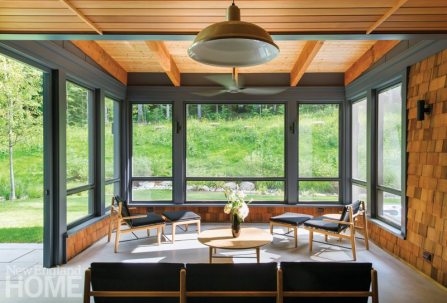 An enclosed porch lets the owners appreciate the outdoors all year.
