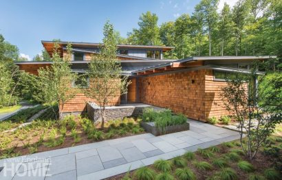 The minimalist landscape architecture by Keith Wagner suits the modern house.