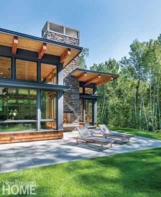 Tall, broad windows blur the indoor-outdoor line.