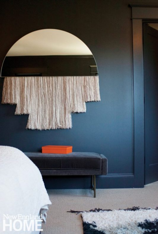 The large-scale blackened steel Ellipse table. Hand-spun, hand-painted silk fiber hangs from the Half Moon mirror.