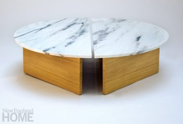 The two halves of the Half Moon coffee table are placed together to create dynamic spacing in the center of the table.