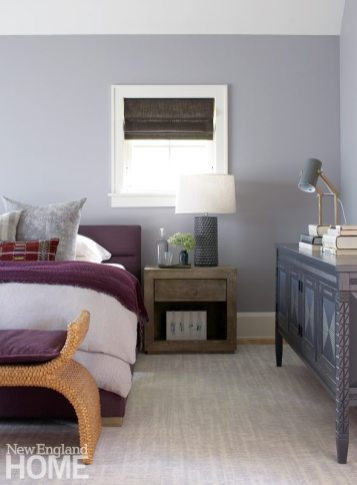 A dresser with tramp art detailing stands out in the simply furnished master bedroom.