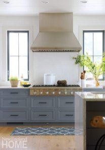 Oversize drawer pulls match the assertiveness of the black window frames.