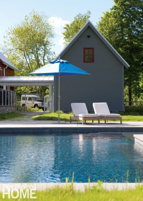 A covered walkway links the house to a second garage while also serving as a gateway to the pool.