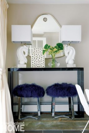 Blue console with polished marble lamps.