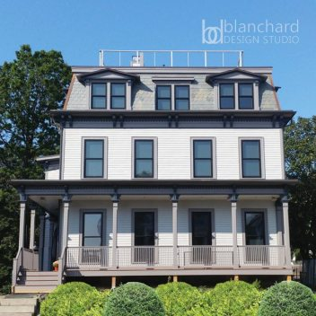 Second Empire home with a mansard roof was restored under the direction of Chelsea Blanchard.