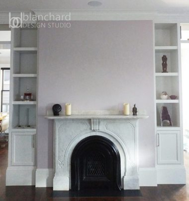 Blanchard saved the original marble mantle of this Boston home and replacing the original coal-burning fireplace with a gas burning one. The wall behind the fireplace conceals ductwork and mechanical systems.
