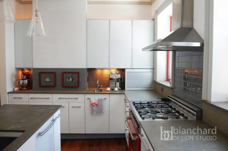 Good design can transcend budget. The focal point of this seemingly high-end kitchen is Ikea cabinetry.